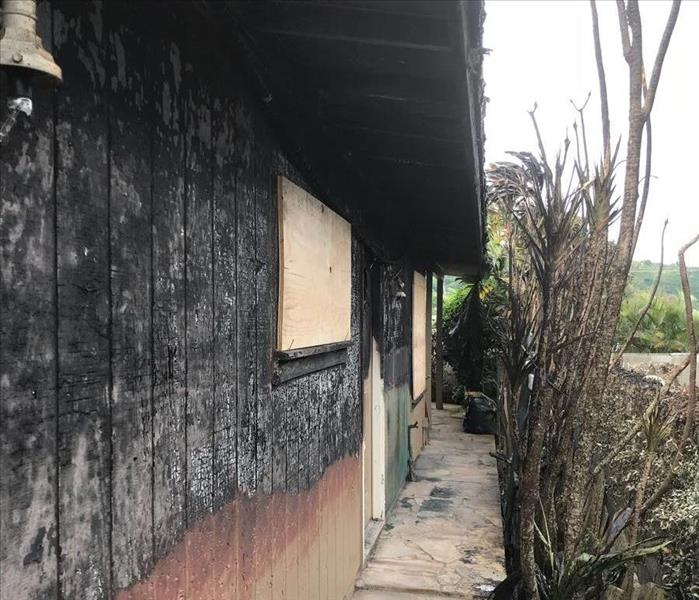 exterior wall of home charred black