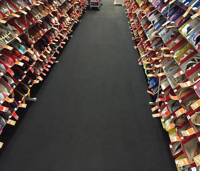 payless aisle with dry carpet