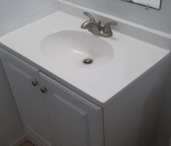 New white sink counter in bathroom