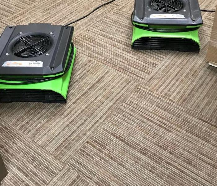 two servpro fans on top of dry carpet