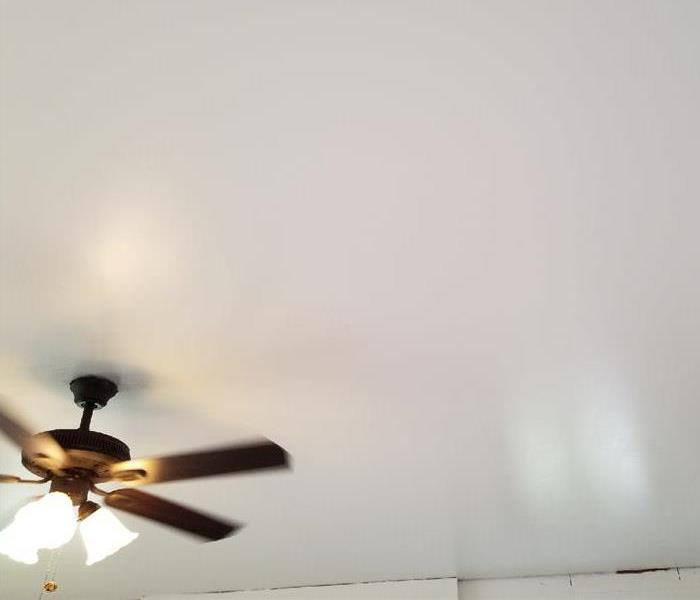 fresh white paint on smooth ceiling